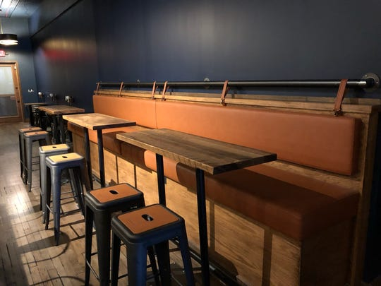 A leather banquette along the south side wall of the 50-seat tasting room.