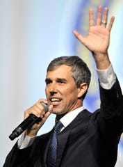 Presidential candidate Beto O'Rouke waves at the crowd.