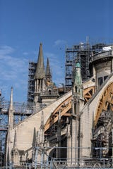 Workers do preliminary work to repair the fire damage at the Notre-Dame de Paris Cathedral.