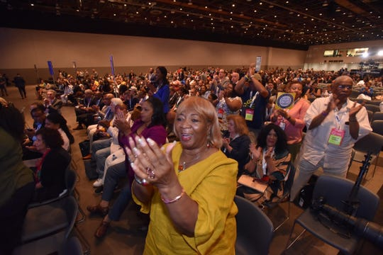 NAACP national board member Gloria Sweet-Love of Brownsville, Tennessee, claps as former N.Y. Mayor Michael Bloomberg speaks Wednesday morning.