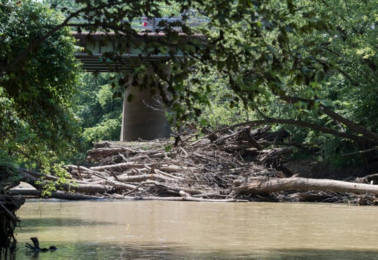 Pigeon Creek at Stringtown Road and Cardinal Drive where a water rescue attempt ended in a false alarm July 23, 2019, after a boater spotted an overturned kayak stuck in the debris, Wednesday, July 24, 2019.