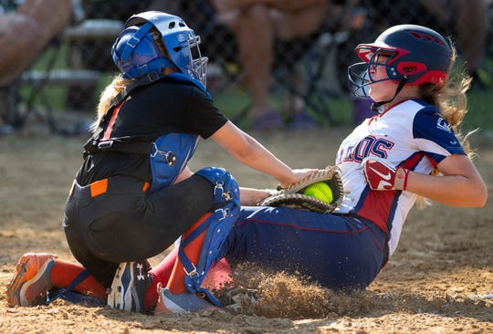 The Midwest Astros' Ali Ward is tagged out by the Warriors' catcher during their game at the USSSA Indiana Great Lakes Nationals in Boonville, Ind., Saturday morning, July 20, 2019. The Astros beat the Warriors 7-0 to advance in the tournament.