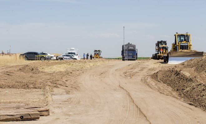 Oilfield workers discovered bones in rural Weld County northwest of CR 34.5 and CR 49. Authorities are investigating the scene, pictured here Wednesday morning.