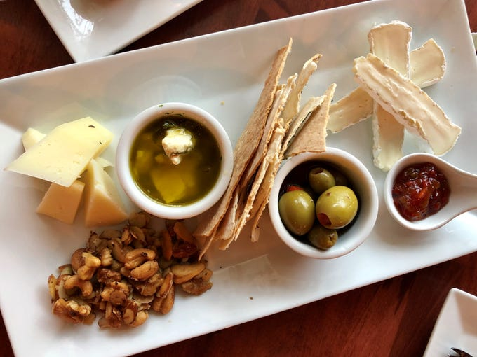 Crisp Creperie's cheese plate features an assortment of cheeses, olives, pepper jam and spiced nuts.