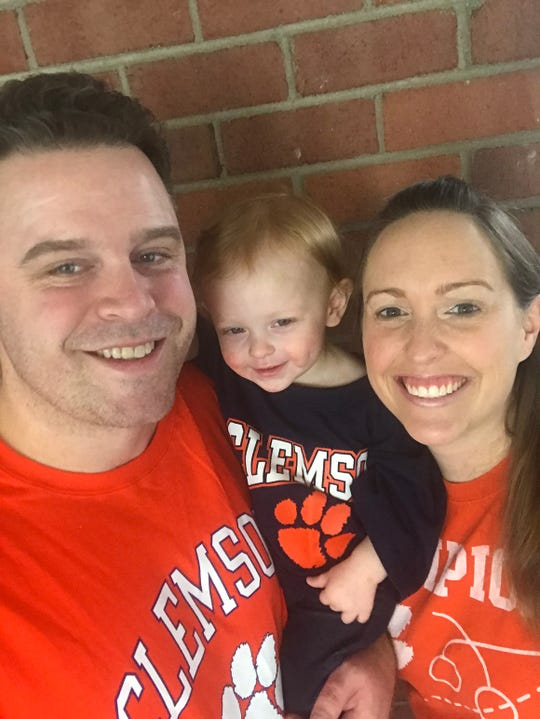 Long-distance Clemson fans: Dan and Jess Duffy with daughter Greta