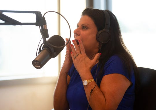 Heidi Aiken works on the The Hawk and Tom Morning Show Thursday, July 18, 2019.