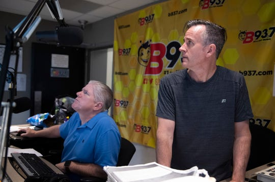 Tom Steele and Hawk Harrison prepare for their next on-air segment during the The Hawk and Tom Morning Show Thursday, July 18, 2019.
