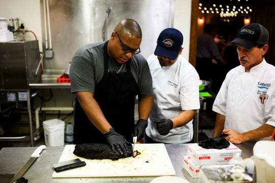 Chef and owner of Bobby's BBQ Octavius Nelson cuts smoked brisket in the kitchen during a Special Evening Edition of Lunch with Lillia at Larkin's Sawmill Tuesday, July 23, 2019.