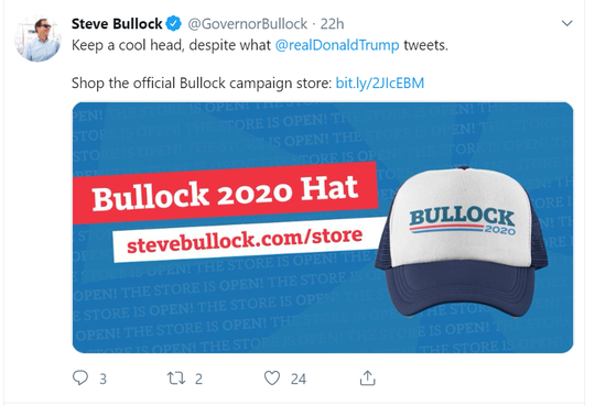 Gov. Steve Bullock hawks one of the advantages to buying one of his hats.