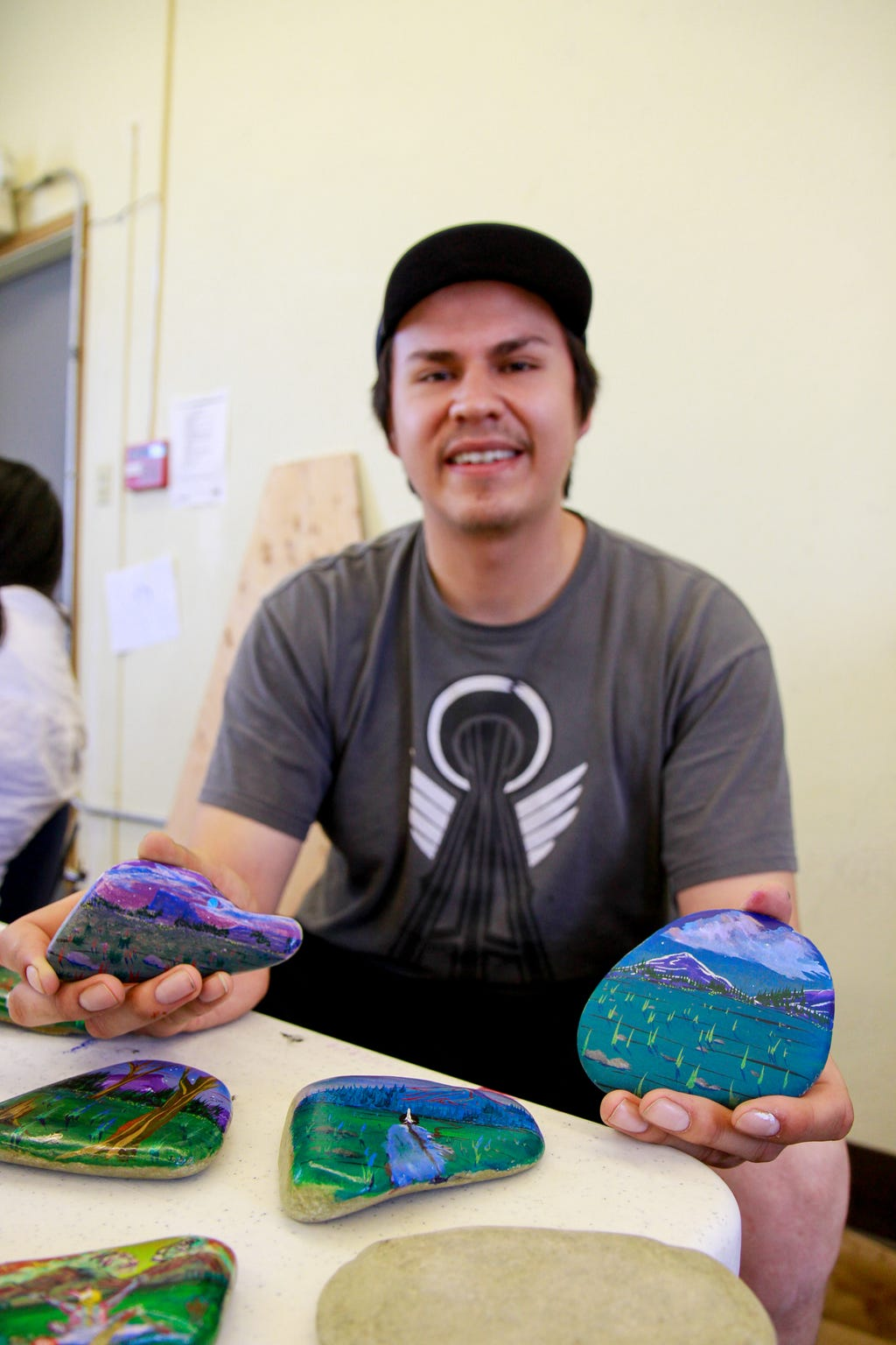 John Marceau displaying his rock art at the Museum of the Plains Indian on Tuesday