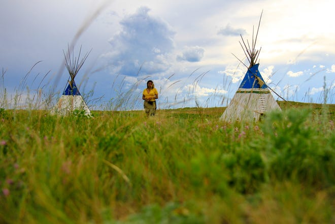 Enya Spicer in the village at the Lodgepole Gallery and Tipi Village in Browning