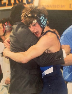 Ethan May, right, in the embrace of his father, Fairfield wrestling coach Mike May, after Ethan won his second and final state Class B wrestling championship in 2008 at Billings' Rimrock Auto Mall Arena.