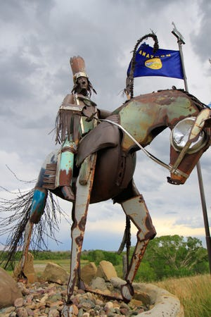 Blackfeet Nation roadside, scrap metal sculpture on the way to Browning