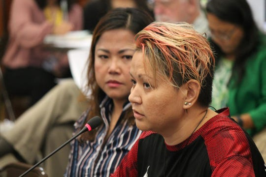 Rose Hermoso, left, and Josette Quinata, right, testify during a public hearing July 24 at the Guam Congress Building, stating their support for a bill related to the island's sex offender registry.