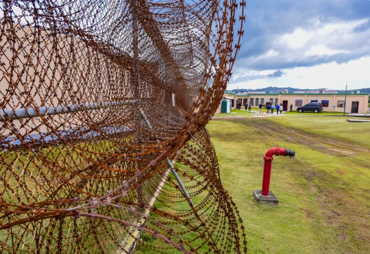 Coils of razor wire serve as an additional layer of security around Department of Corrections' maximum security unit, Post 6, during a walkthrough tour conducted on Thursday, Aug. 23, 2018.