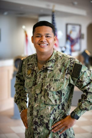 """Seaman Robert Rabago, of Talofofo, Guam, is serving at Naval Station Mayport, Florida as a master at arms who is responsible for providing security to the installation and harbor. Rabago credits his hometown for giving him opportunities he would not have had otherwise experienced that have helped in naval service. """"I gained the ability to adapt well. Loyalty is big in Guam. Always looking at the bright side of situations,"""" said Rabago. """"All of these values are extremely important in succeeding in the Navy."""" He is a 2016 Guam Community College graduate."""