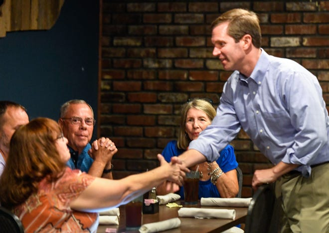 Democratic candidate for Kentucky governor, Andy Beshear, greets active and retired teachers during a stop in Henderson, at Rookies Sports Bar & Grill Tuesday, July 23, 2019.