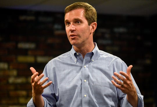 Democratic candidate for Kentucky governor, Andy Beshear, talks with active and retired teachers during a stop in Henderson, at Rookies Sports Bar & Grill Tuesday, July 23, 2019.