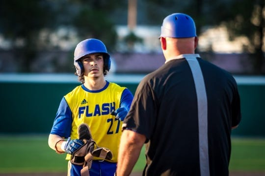 Henderson Flash catcher Brandon Boxer, left, talks to manager J.D. Arndt during a recent game at B.T. Wayne Field.