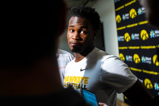 Iowa guard Joe Toussaint speaks with reporters during a men's basketball player media availability, Wednesday, July 24, 2019, at Carver-Hawkeye Arena in Iowa City, Iowa.