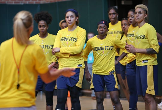 Indiana Fever guard Erica Wheeler, center, listens to a coach during practice, at Bankers Life Fieldhouse, Wednesday, July 17, 2019. She grew up in a rough area in Miami, but her mother wanted her to get out.  Basketball helped keep Wheeler out of trouble. She played basketball at Rutgers but losing her mother hit her hard at the end of her college career. She ended up playing in Brazil, Puerto Rico, and New York. She became an undrafted free agent going to the WNBA's Fever. She recently became the fifth undrafted player in the WNBA to record 1,000 points and 500 assists.