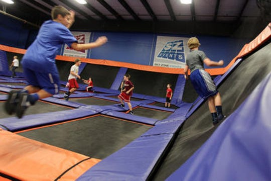 Kids will jump for joy if you hold your party at one of many trampoline parks around the area. This is SkyZone.