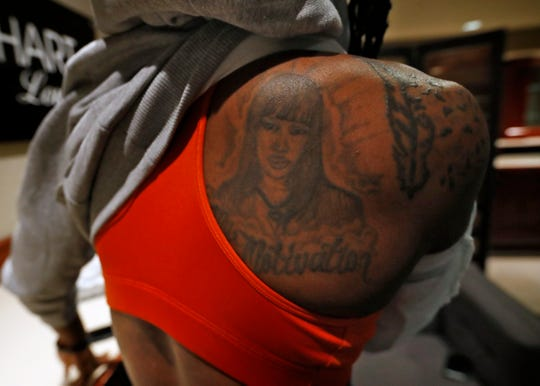 Indiana Fever guard Erica Wheeler shows some of her symbolic tattoos, at Bankers Life Fieldhouse, Wednesday, July 17, 2019. This tattoo on her shoulder is of her mother. She grew up in a rough area in Miami, but her mother wanted her to get out. Basketball helped keep Wheeler out of trouble. She played basketball at Rutgers but losing her mother hit her hard at the end of her college career.  She ended up playing in Brazil, Puerto Rico, and New York. She became an undrafted free agent going to the WNBA's Fever. She recently became the fifth undrafted player in the WNBA to record 1,000 points and 500 assists.