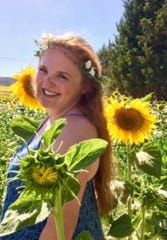 Katie Vitosh in a field of sunflowers.