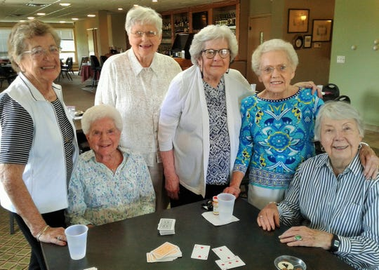 These smiling 90+ year-old women were present for bridge recently at the Elks Club in Iowa City, part of a larger group which has been meeting here weekly for about 50 years. From left, they are Marylou Gatens, Nora Lee Balmer, Lois Coon, Hazel Miller, Marilyn Alberhasky and Shirley Dickinson. Two more members in this age bracket not present were Loretta Angerer and Mardella Carlson.