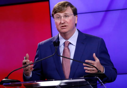 Lt. Gov. Tate Reeves responds to a question during a televised GOP gubernatorial primary debate in Jackson, Miss., Tuesday, July 23, 2019. (AP Photo/Rogelio V. Solis)