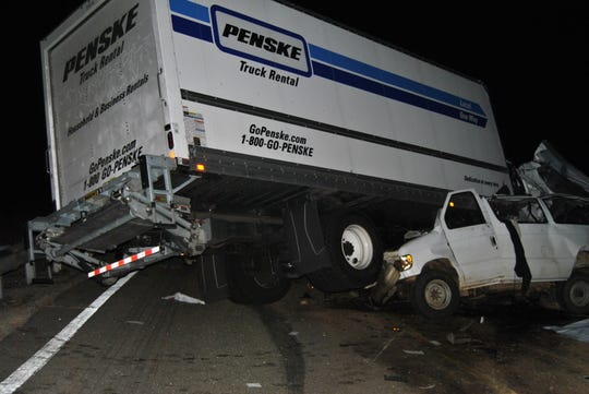 View west from eastbound traffic lane showing truck and van at final rest.