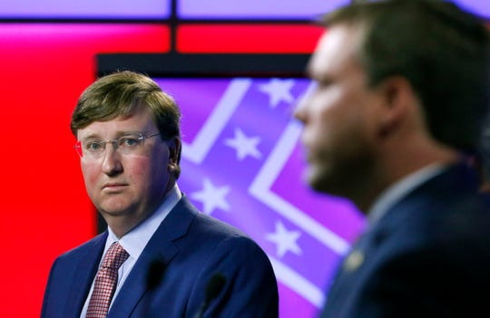 Lt. Gov. Tate Reeves looks at Rep. Robert Foster, R-Hernando as he answers a question during a televised GOP gubernatorial primary debate in Jackson, Miss., Tuesday, July 23, 2019. (AP Photo/Rogelio V. Solis)