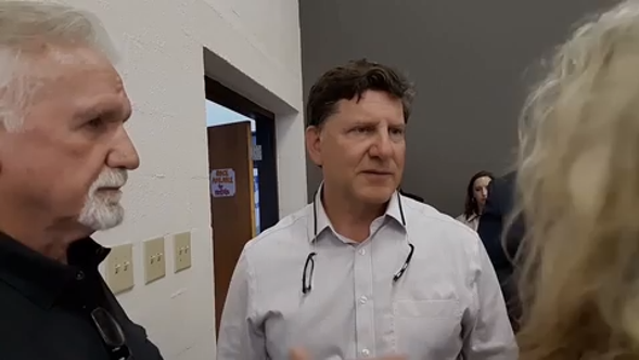 TVA CEO Jeff Lyash meets with sickened Kingston coal ash workers at a TVA open house.