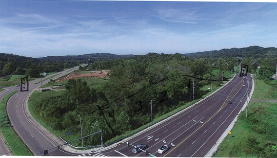 SW corner at Schaad Road lookng west on Oak Ridge Highway, with lots 1, 2, 3, and 4 in the background.