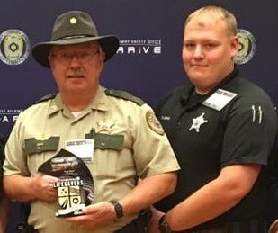 Grundy County Sheriff's Office Chief Deputy Tony Bean and son Sgt. T.J. Bean are pictured in a photo that was posted to the agency's Facebook page.