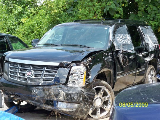 A photograph of Shannon Hercutt's 2007 Cadillac Escalade shows damage incurred when it plunged down a 125-foot embankment in Sevier County on August 3, 2009.