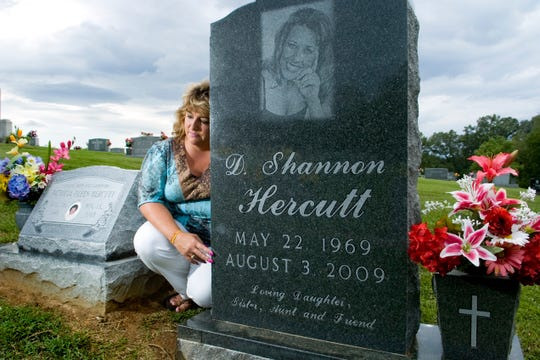 Penny Stephens, sister of Shannon Hercutt, sits at her sister's grave in Sevierville on Wednesday, July 28, 2010.