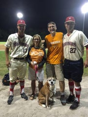 John and Pennye Wilkerson have been visiting the Cape Cod League for the past 16 summers. Here they are pictured in 2018 with University of Tennessee players Andre Lipcius (left) and Garrett Stallings (right) at a Harwich Mariners game.