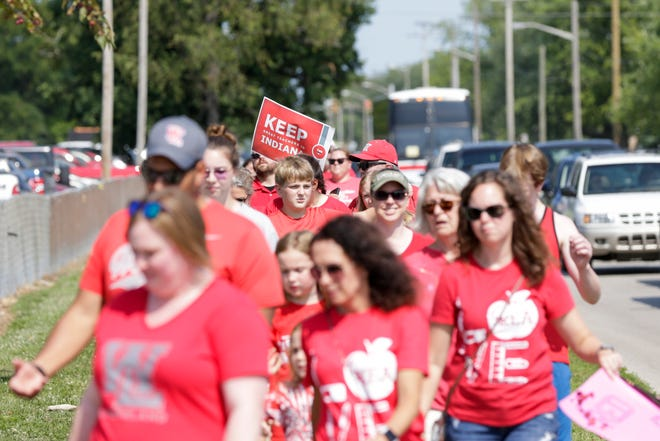 About 60 teachers and community members march from Lafayette Jeff High School to the Tippecanoe County fairgrounds, Tuesday, July 23, 2019 in Lafayette. The group walked to call attention to the need for continued support for public education, according to a news release.