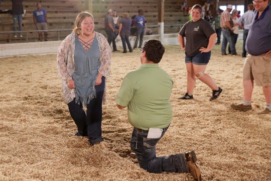 Aaron Doke of Lafayette proposes to Hannah Lyon of Russiaville during the fourth day of the 2019 Tippecanoe County Fair, Tuesday, July 23, 2019 in Lafayette. The fair continues until Saturday, July 27.