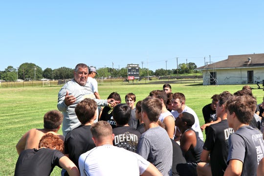 "Kaplan Football Head Coach Stephen ""Tank"" Lotief Going giving instructions to his team. Wednesday, July24, 2019"