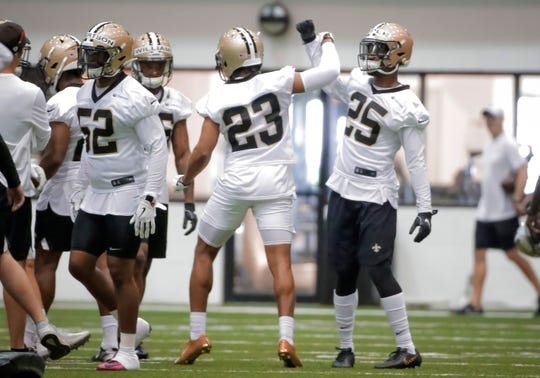 New Orleans Saints cornerback Marshon Lattimore (23) and cornerback Eli Apple (25) celebrate during a minicamp session June 11 at the New Orleans Saints Training Facility.