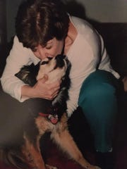 Brenda Gould with one of her dogs. Gould buried her pets in Heavenly Acres Pet Cemetery which closed in 2018.