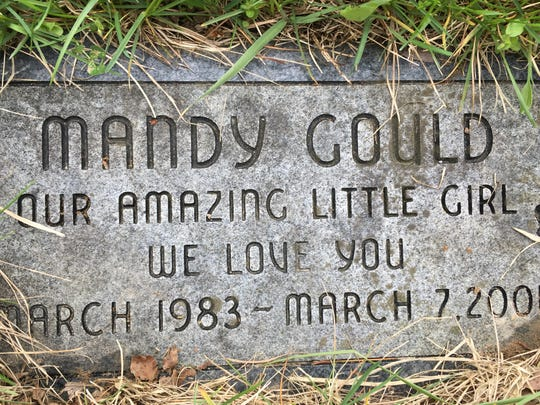 The gravestone of Brenda Gould's dog Mandy buried in Heavenly Acres Pet Cemetery.