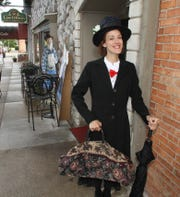 Cathleen Edgerly sports a Mary Poppins outfit during the 2014 Literary Pub Crawl in Howell.
