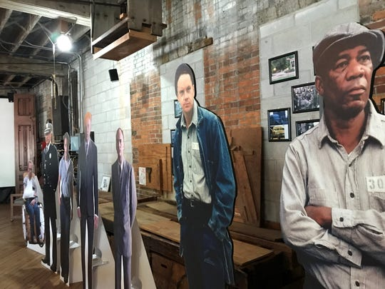 "These cardboard cut outs of some of the actors including Tim Robbins and Morgan Freeman at right in ""The Shawshank Redemption"" stand inside the Shawshank Woodshop and Museum in Upper Sandusky where the woodshop scene was filmed in the summer of 1993.  The woodshop saws will be running during re-enactments Aug. 16-18 during the Shawshank 25th reunion."