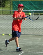 Gabe Matvichuk of Ontario returns a shot in the boys 10 final of the 86th News Journal/Richland Bank Tennis Tournament at Lakewood Racquet Club