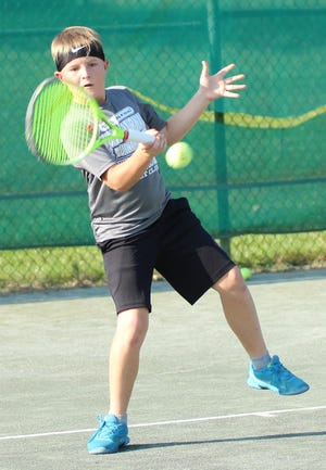 Philip Etzel of Lexington repeated as the boys 10 singles champ Tuesday in the 86th News Journal/Richland Bank Tennis  Tournament at Lakewood Racquet Club.