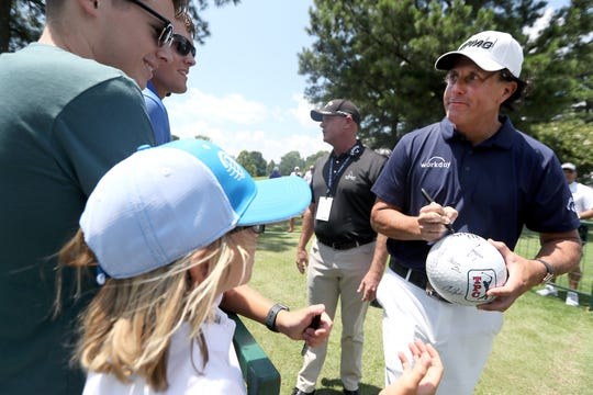 Phil Mickelson signs autographs for fans at the WGC-FedEx St. Jude Invitational at TPC Southwind on Wednesday, July 24, 2019.