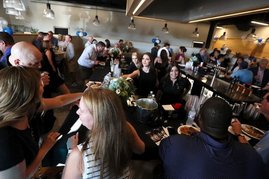 Let It Fly sportsbar, a business venture of Memphis Basketball assistant coach Mike Miller, holds a preview event at the Germantown location on Tuesday, July 23, 2019.